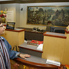 Art historian Judy Curtis, who wrote a the book on<br /> artist W. Lester Stevens, looks at his paintings displayed at Rockport National Bank's Main Street location in Rockport.