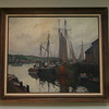One of the two signature harbor scenes by Emille Gruppe hanging at BankGloucester.