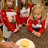 Eloise Ciaramitaro, Amanda Mohan, and Madeline Ciaramitaro learn how to make Pinulata.