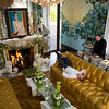 """Alexander Westerhoff relaxes in the living room of """"Serenity"""" the home he and Tom Lang, right, own in Manchester-by-the-Sea. <br /> The mantel is from the Doris Duke estate in Newport, R.I. mid 18th-Century English, which they painstakling restored.<br /> The marble Venetian  lions flanking the fireplace are early 17th-Century.  Photo by Mary Muckenhoupt."""
