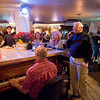 "William Shepard -- ""Wild Bill""  as Joe calls regular  has been singing with Joe since the 90's at the Studio on Rocky Neck <br />  He belts out a tune during a Saturday night piano bar session at Giuseppe's Ristorante and Piano Bar with owner Joe at the piano.<br /> Photo by Desi Smith."