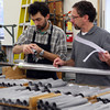 Thibaut Lenfant, left, measures pipe with Micahel Kraft. Lenfant in from France and is on exchange working at C.B.Fisk, Inc. for a year to learn their techniques of organ making.<br /> Photo by Amy Sweeney