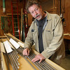 Dana Sigall, an organ builder at Charles B. Fisk Co. describes how the organ is built.<br /> Photo by Allegra Boverman.