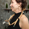 "Manchester, MA. artist, Linda Holt modeling artist Claire Sanford's neckpiece - ""Sticks & Stones"" made from wood, patinated copper, and rocks.  The wood is gathered from the land surrounding Claire's studio in West Gloucester and the rocks are collected from local beaches."