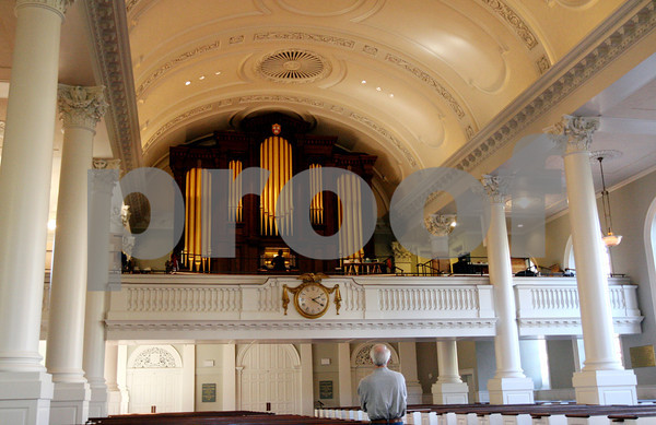ALLEGRA BOVERMAN/Staff photo. Cambridge: David Pike, foreground, the tonal director for C.B. Fisk, listens as Mika Oba, an organbuilder with Fisk, plays notes on the newly installed pipe organ inside Memorial Church at Harvard University. They are finetuning the organ pipe by pipe.