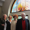 Photo by Frank J. Leone, Jr.  Event organizers, from left, Sharon Pollard of Methuen, preservation chairman, Patty George of Salem, special events chairman, Ann Gustaferro of Lawrence, Festival of Trees president and Jim Smith of Methuen, chairman of Nevins Library board stand in front of one of the 25 stained glass windows, donated to the library by the Festival's $114,000 grant from the Festival of Trees proceeds during the Methuen Festival of Trees Kick-Off Luncheon and Stained Glass Window Donation and the Nevins Memorial Library in Methuen. 10/16/11<br /> , Photo by Frank J. Leone, Jr.  Event organizers, from left, Sharon Pollard of Methuen, preservation chairman, Patty George of Salem, special events chairman, Ann Gustaferro of Lawrence, Festival of Trees president and Jim Smith of Methuen, chairman of Nevins Library board stand in front of one of the 25 stained glass windows, donated to the library by the Festival's $114,000 grant from the Festival of Trees proceeds during the Methuen Festival of Trees Kick-Off Luncheon and Stained Glass Window Donation and the Nevins Memorial Library in Methuen. 10/16/11