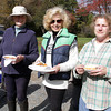 From left, Linda Bennett, of Kensington, NH, Judi Milano, of Boxford, and Carol Pelletier, of Rowley, eat some lunch following a charity ride for Windrush Farm Theraputic at Bradley Palmer Park. David Le/Cape Ann Magazine