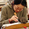 Photo by Allegra Boverman<br /> Mika Oba prepares a pipe for voicing at C.B. Fisk Inc. located in Gloucester.