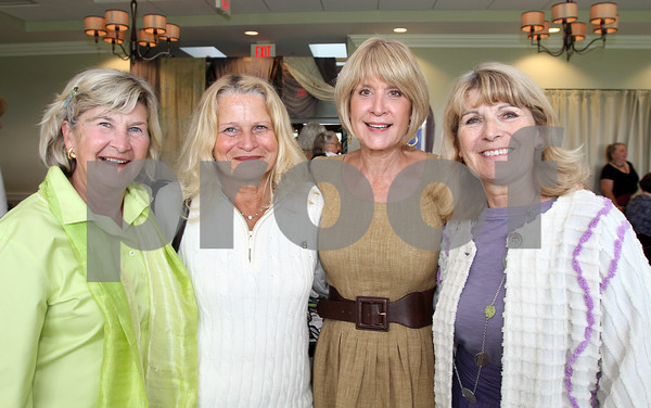 From left, Judy Bidwell, Lynda Walsh, Kathy Hamilos, and Janice Lloyd, attended seARTS Wearable Art Benefit at Bass Rocks Golf Club. David Le/Cape Ann Magazine