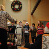 Carolers sing at the Rockport Inn & Suites during last year's open house. The inn is located at 183 Main St.<br /> Photo by Desi Smith.