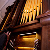 ALLEGRA BOVERMAN/Staff photo. Cambridge: Mika Oba, an organbuilder with C.B. Fisk, works on the newly installed pipe organ inside Memorial Church at Harvard University. She and tonal director David Pike are finetuning the organ pipe by pipe.