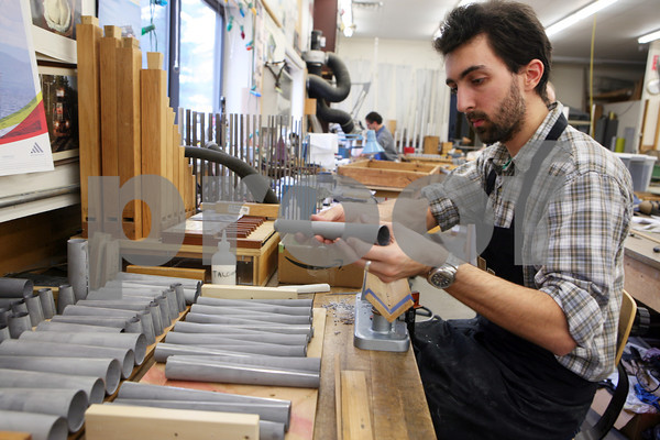 Thibaut Lenfant works on pipes at C. B. Fisk Inc.. The company makes almost every part of the organ in its shop.<br /> Photo Amy Sweeney
