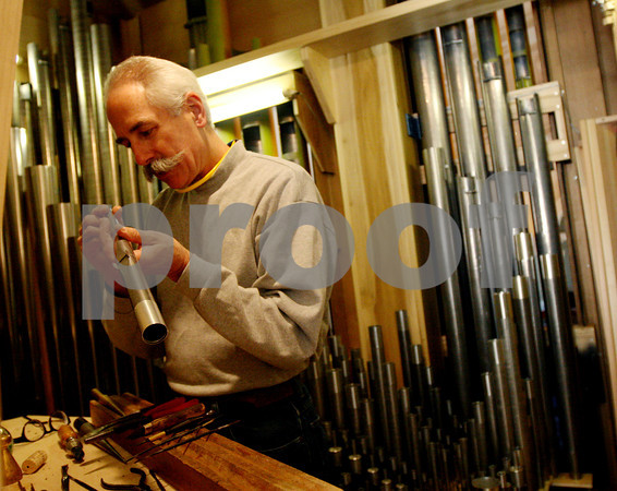 ALLEGRA BOVERMAN/Staff photo. Cambridge: David Pike, the tonal director for C.B. Fisk, inside the pipe organ inside Memorial Church at Harvard University. He and his team are finetuning the organ pipe by pipe.