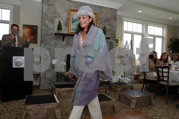 Susan Boles of Gloucester modeling  Cape Ann Artisan, Sara Wright's hand-woven sweater jacket and hat during runway portion of Celebrate Wearable Art! fashion event.