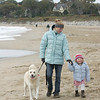 "Manchester: Kelly Lapesa and her daughter Morgan, 2, walk their dog Baxter on Singing Beach.  Lapesa said that she walks her dog on the beach in the winter all the time saying ""It's good exercise for the dog and for us."" Mary Muckenhoupt/Gloucester Daily Times"
