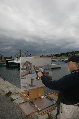 Rockport: Donald Mosher of Rockport works on an oil painting at Pigeon Cove Harbor. Staff Photo/Kristen Olson.