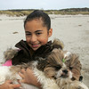 Gloucester:  Rosalee Heaney-Balf, 11, and her dog Tucker on Good Harbor Beach.  Mary Muckenhoupt/Gloucester Daily Times.