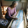 Gloucester: Joan Frank paints on silk scarves in her studio located in her Haskell Street home.  Staff