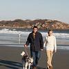 Gloucester: Joel D'Ambrosio and Taylor Dougwillow, both of Gloucester, walk their friend's dog Jenna, an Alaskan Husky on Good Harbor Beach. Staff photo/Amy Sweeney