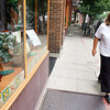 Mayor Carolyn Kirk walks down Main Street in Gloucester. She talks about the economic impact of having the Run Gloucester race. Kate Glass/Staff photo.