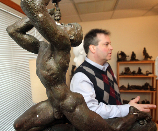 "Sculptor Daniel Altshuler in his studio in Gloucester. One of his works, titled ""Piper,"" is at left. Photo by Allegra Boverman"