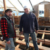 Shipwrights  Leon Poindexter and John Gardner on The Beaver where the deck was being laid. Photo by Allegra Boverman
