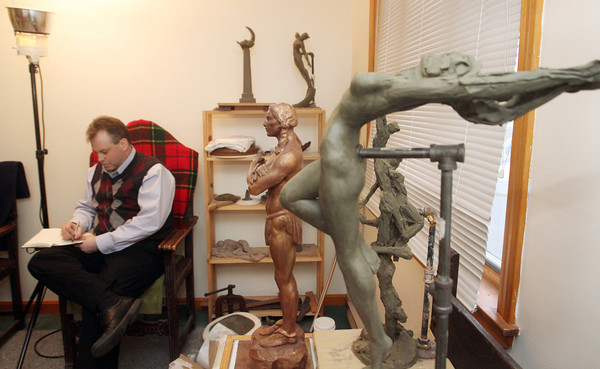 Throughout his studio overlooking the city,  Daniel Altshuler has sculptures on pedestals, art books, sketches, modeling tools and spatulas. On pedestal, lower right, from left, are Massasoit, Cold Spring and The Four Winds. On shelf, back wall, from left are: Spirit of the Night and Spanish Dancer. Photo by Allegra Boverman