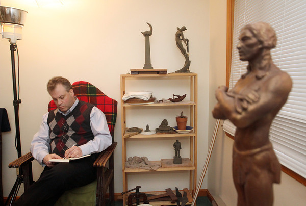 Sculptor Daniel Altshuler in his studio in Gloucester. At right, is Massasoit.  On shelf, back wall, from left are: Spirit of the Night and Spanish Dancer. Photo by Allegra Boverman