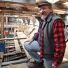 Shipwright Leon Poindexter inside The Beaver. Photo by Allegra Boverman.