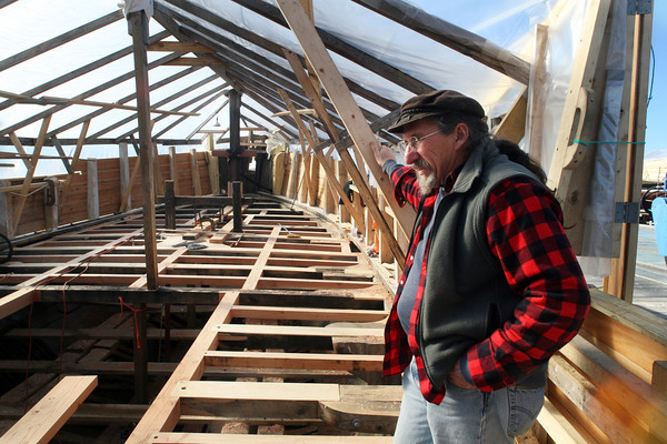 Shipwright Leon Poindexter on The Beaver where the deck was being laid. Photo by Allegra Boverman