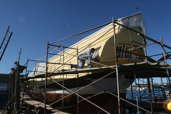 Shipwright Steve Morrisseau was installing new windows on The Eleanor. Photo by Allegra Boverman.