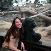 Brandi Baitchman, senior zookeeper at the Franklin Park Zoo, sits in front of the Tropical Forest exhibit while Kiki, age 30, holds her third baby Kambiri, age 1.<br /> Photo by Desi Smith.