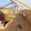 Master Shipwright Leon Poindexter walks up to the top deck of the Eleanor<br /> Photo by Allegra Boverman.