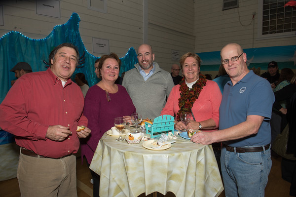Desi Smith/Staff Photo. From left to right, Jack and Linda Pallazola, Randy O'neil, Noreen and Brad Gilliss took part in the 20th Annual Taste of Magnolia Food & Fine Beverage Festival that was held Friday, Nov. 21, 2014 at the Magnolia Library and Community Center.