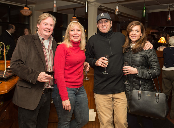 Desi Smith/Staff Photo. From left to right,  Peter and Vickie Van Nes, Joey Ciaramitaro and Katelyn Foley all of Gloucester, attended the Grand Opening Party at Pinoli, the new italian restuarant at 3 Duncan Street that replaced Alchemy on December 16,2014.