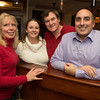 Desi Smith/Staff Photo. From left to right,  Vickie Van Nes, Melissa Cox, Mark McDonough owner of Pinoli and Greg Verga all of Gloucester, came to shoew their support at the Grand Opening Party at Pinoli, the new italian restuarant at 3 Duncan Street that replaced Alchemy on December 16,2014.