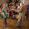 Desi Smith/Cape Ann Magazine.   John Pettibone, curator of Hammond Castle, talks with Matthew Davidson, 11, of Peabody, and the audience about how chainmail headpieces would protect swordsmen in medieval battles.