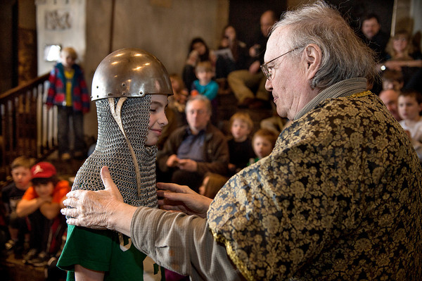 Desi Smith/Cape Ann Magazine.   John Pettibone of Hammond Castle fits Matthew Davidson, 11, of Peabody with a chain mail headpiece and helmet worn by swordsmen in medieval times, during an event held to entertain and learn.