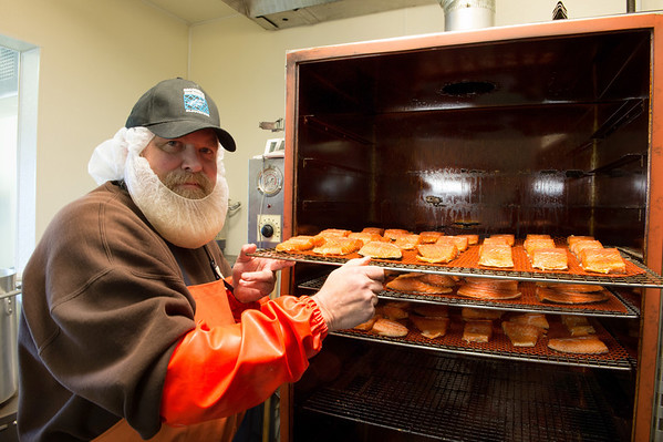 "Desi Smith/Cape Ann Magazine. Paul ""Sasquatch"" Cohan loads some salmon into his fish smoker."