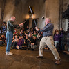 Desi Smith/Cape Ann Magazine.   John O'Connor of Dover, Ma., and Joe Moore of Durham, N.H., got to play with swords in the Great Hall at an event held to entertain and learn at Hammond Castle.