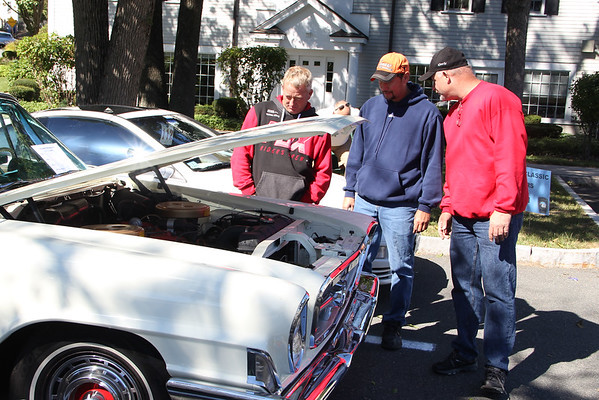 Vincenzo Dimino photo<br /> Checking out a muscle car are, from left, John John Johnson of Beverly, Houng Lee Jr. of Epping, New Hampshire, and Tom Zorellaof Beverly.
