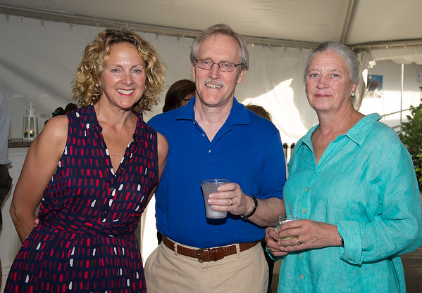 "Desi Smith Photo.    From left, Heather Atwood, Ken and Alice Erickson all from Gloucester, attended the ""Sea to Supper"" community dinner to benefit the Gloucester Fishermen's Wives Association held on August 25,2016 at the Waterfront Pavilion Tent at Mile Marker One Restaurant and Bar."