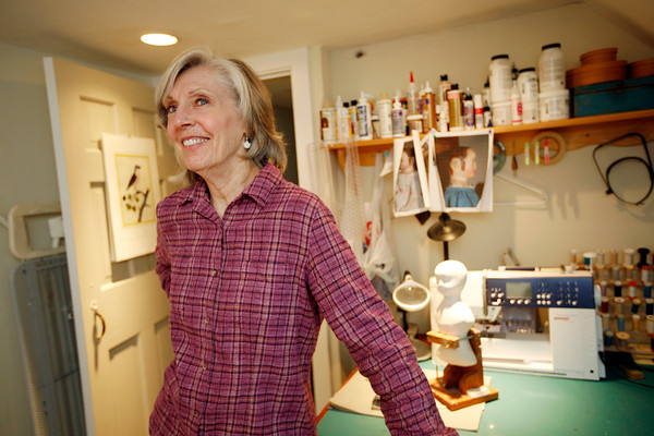 Allegra Boverman/Cape Ann Magazine. Peggy Flavin of Annisquam recreates dolls from the past. She is in her dollmaking studio in her home.