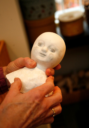 Allegra Boverman/Cape Ann Magazine. Peggy Flavin of Annisquam recreates dolls from the past. This is the head for a doll she's working on.