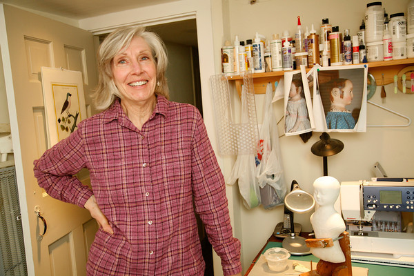 Allegra Boverman/Cape Ann Magazine. Peggy Flavin of Annisquam recreates dolls from the past. She is in her home studio.