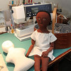 Allegra Boverman/Cape Ann Magazine. Peggy Flavin also creates early cloth dolls, such as this African American doll she calls Carolina. Quite different from her other dolls she makes at left.