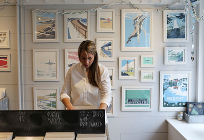 HADLEY GREEN/Staff photo Ingrid Kinnunen flips through prints at Rusty and Ingrid Creative Company in Rockport.   01/27/18