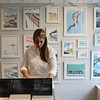 HADLEY GREEN/Staff photo<br /> Ingrid Kinnunen flips through prints at Rusty and Ingrid Creative Company in Rockport. <br /> <br /> 01/27/18