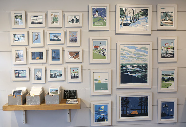 HADLEY GREEN/Staff photo<br /> Prints hang on the wall for sale at Rusty and Ingrid Creative Company in Rockport.<br /> <br /> 01/27/18