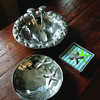 MIKE SPRINGER/Staff photo<br /> A group of sea-themed products from Mariposa, designed by Michael Updike: a Sea Border Serving Bowl with Scallop Shell Salad Servers, a Starfish Medium Bowl, and a Starfish Beaded Napkin Box with Starfish Napkin Weight and textured cocktail napkins.
